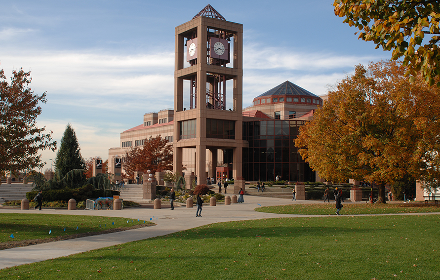Queens College campus with clock tower and library