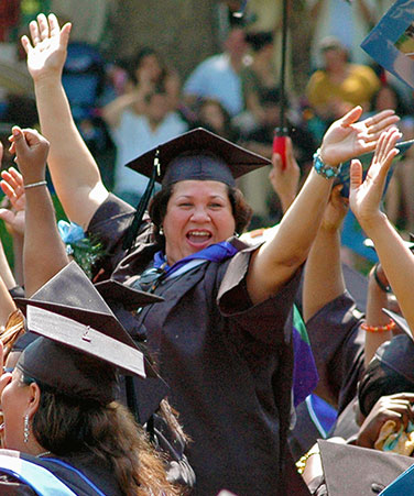 Female graduate celebrating at a 2017 commencement