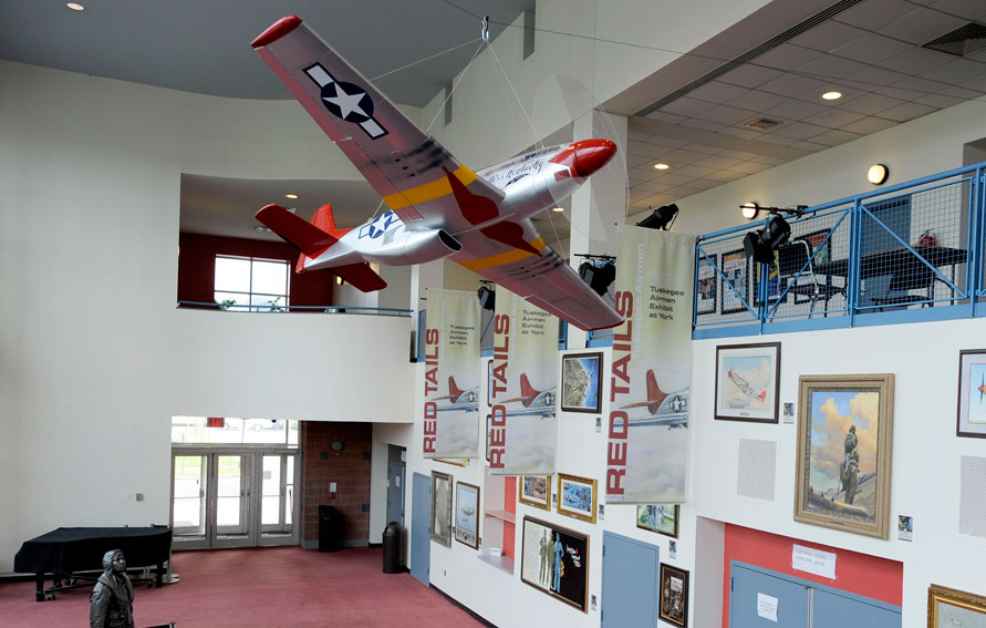 Tuskegee Airmen exhibit at York College showing model of P-51 Mustang