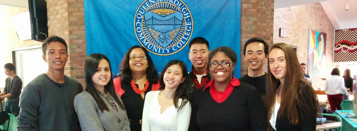 Queensborough Community College banner and students