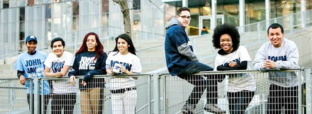 John Jay College sudents wearing clothing with school logos
