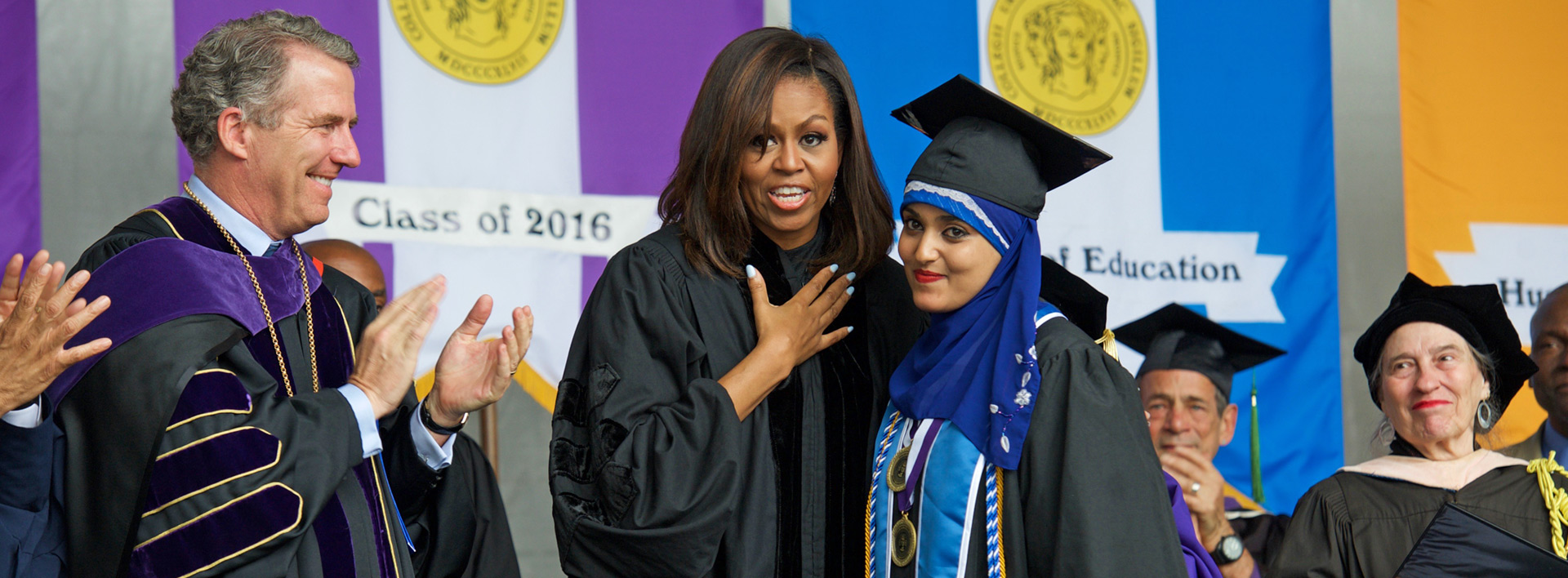 CUNY Chancellor James B. Milliken, First Lady Michelle Obama and Salutatorian Orubba Almansouri at the 2016 CCNY graduation