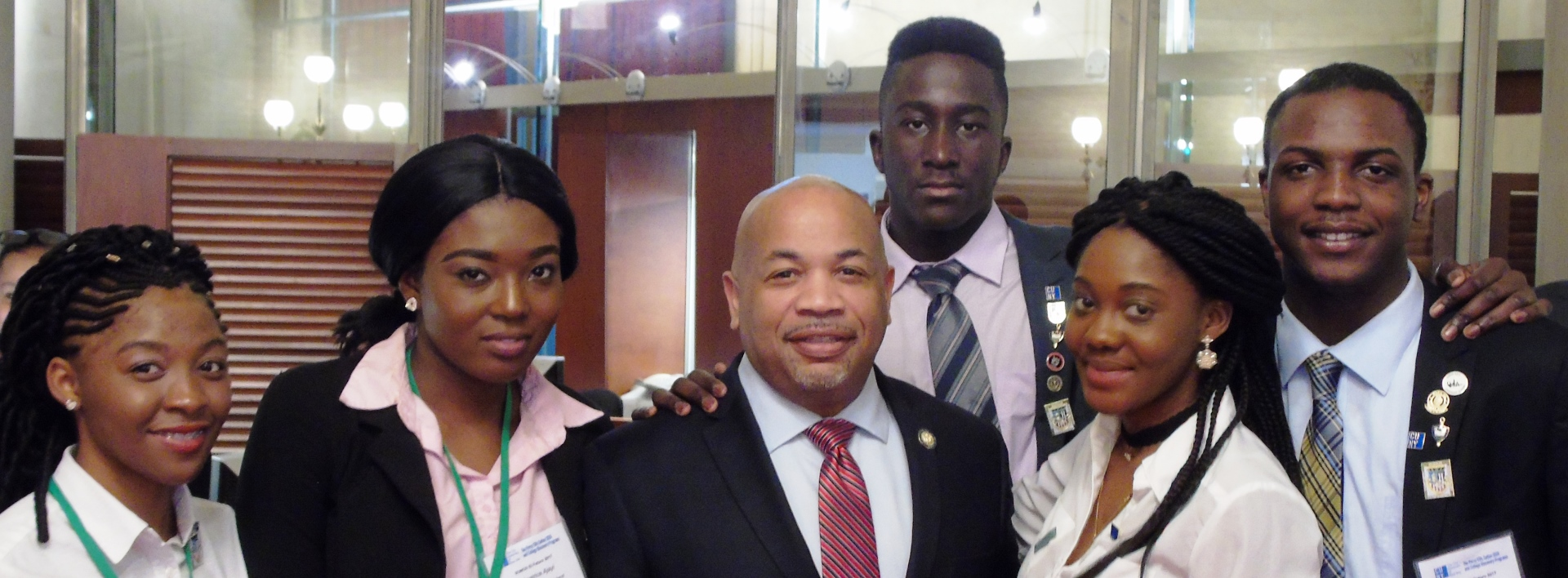 New York State Assembly Speaker Carl E. Heastie with SEEK students banner
