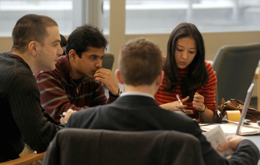 Students collaborating at a table for theEntrepreneurship Certificate Program at Baruch