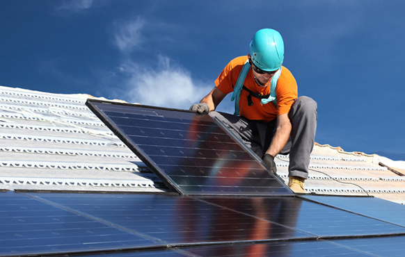 Workman handling solar panels for NYDesigns Solar Plus Pro