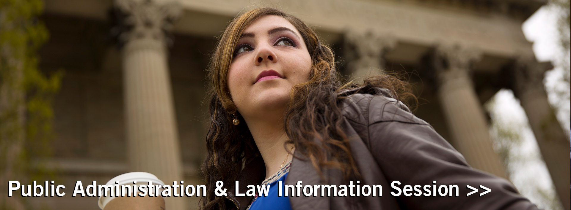 Female law student standing in front of a courthouse for Public Administration and Law Information Session banner