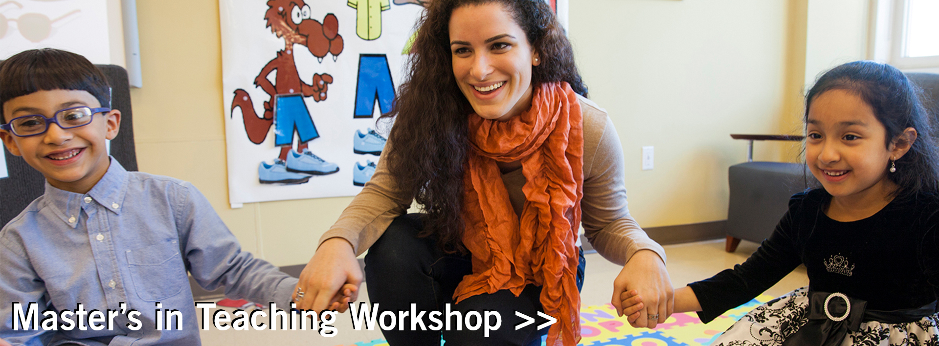 Student teacher with children in a classroom for MASTER'S IN TEACHING WORKSHOP banner