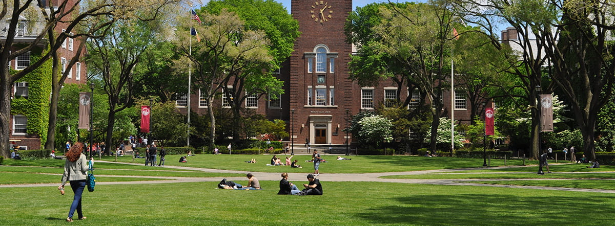 Students on the Brooklyn College quad with the library in the background