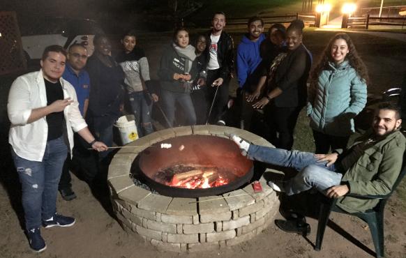 Malave Leadership Academy student roasting marshmallows