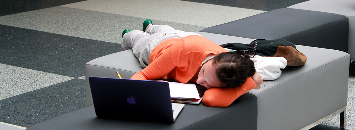 It's Final Week, May 2012 Student Photo Challenge Winner, showing a female student lying down and studying
