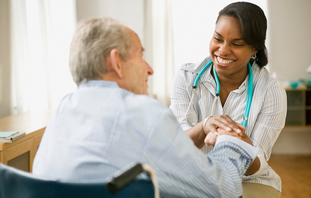 Health aide with a patient