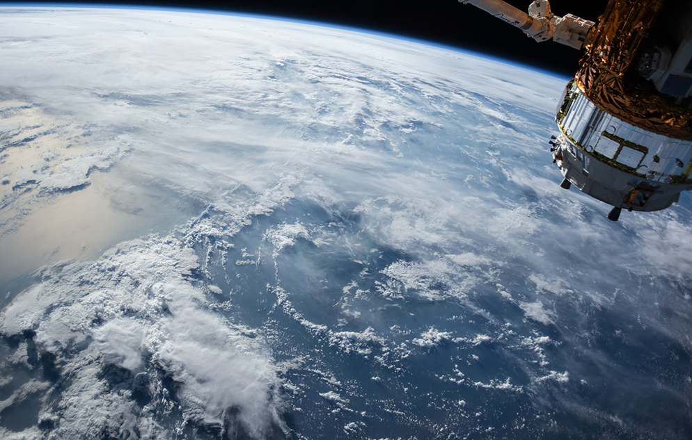 Satellite in space with view of earth