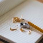 Pencil and pencil sharpener on a notebook for funding graphic\