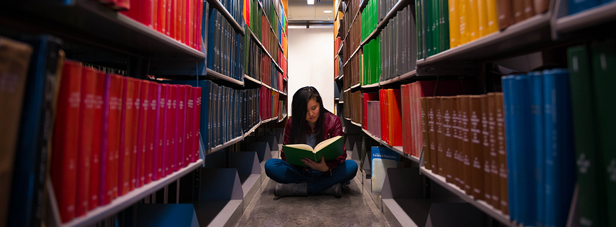 student in the library, BOOKWORM, taken by Josue Mendez, Baruch College