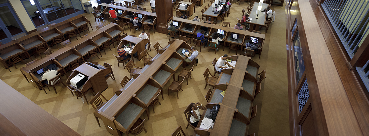 Library desks with students