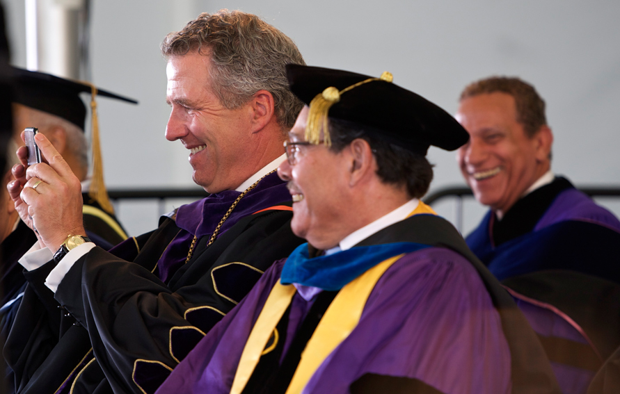 CUNY Chancellor James B. Milliken (l) taking a picture at the 2016 Lehman College commencement