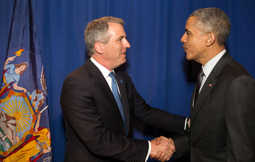 CUNY Chancellor James B. Milliken (l) shaking hands with President Barack Obama on his visit to Lehman College for the My Brother's Keeper program